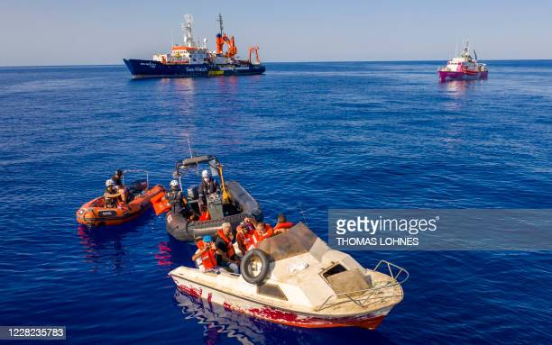 Picture taken on August 22 2020 and released on August 28 2020 shows three small rescue boat that are part of the SeaWatch 4 civil sea rescue ship...
