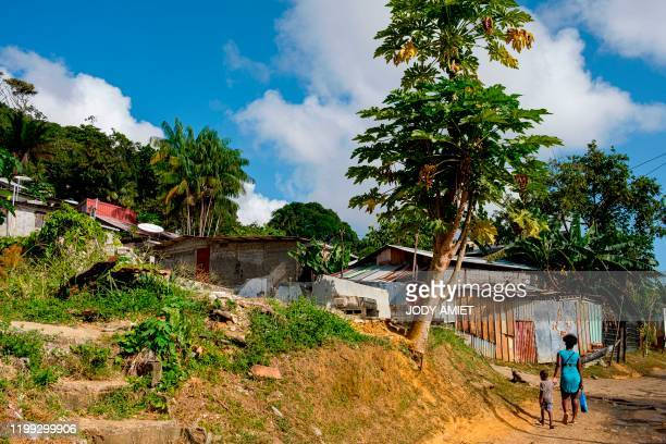 A picture taken on August 23 2017 in Cayenne French Guiana shows a view of Mont Baduel district where makeshift housing have been destroyed by the...