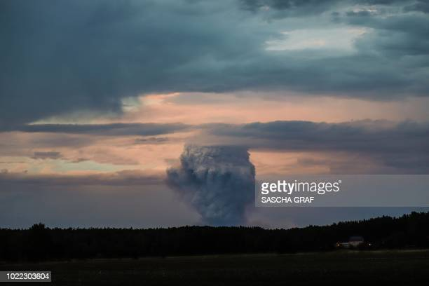 Picture taken on August 23, 2018 from Bad Schmiedeberg, northeastern Germany, shows smoke rising from a forest fire raging 50 kilometres southwest of...