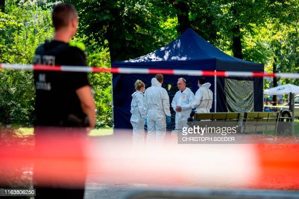 Picture taken on August 23 2019 shows forensic experts of the police securing evidences at the site of a crime scene in Berlin's Moabit district...