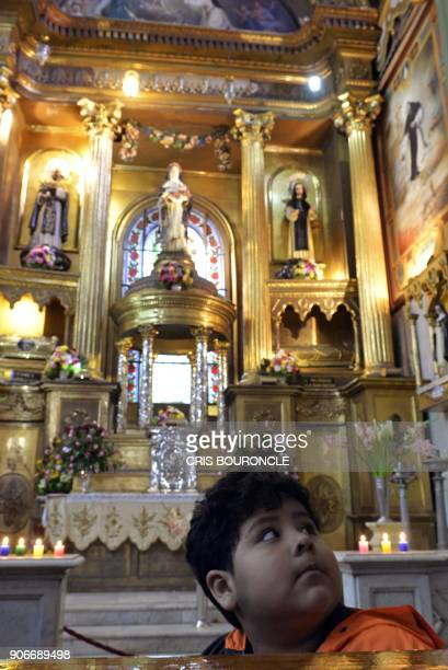 Picture taken on August 24 2014 of faithful visiting the altar of the Basilica and Convent of Santo Domingo in Lima where the relics of Peruvian...
