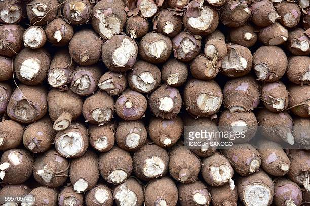 A picture taken on August 25 2016 shows a pile of cassava on the back of a truck in the market of Adjame in Abidjan / AFP / ISSOUF SANOGO