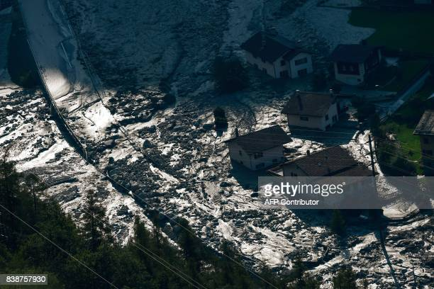 A picture taken on August 25 shows a general view of the village of Bondo in the Swiss Alps following a landslide two nights ago Eight people were...