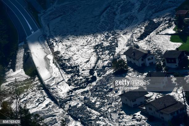 TOPSHOT A picture taken on August 25 shows a general view of the village of Bondo in the Swiss Alps following a landslide two nights ago Eight people...