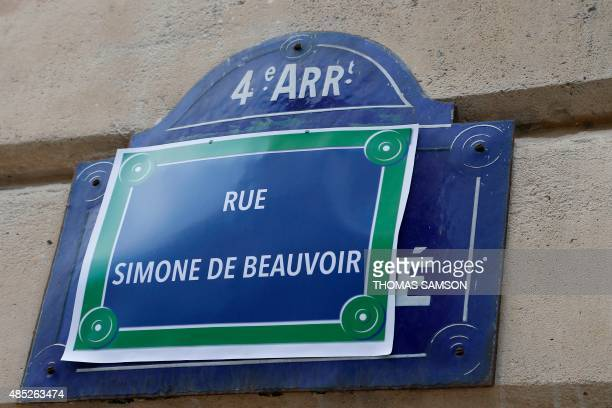 A picture taken on August 26 2015 in Paris shows a placard reading 'Simone de Beauvoir street' is sticked on a street sign of the 'Ile de la Cite' by...