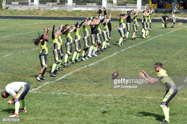 A picture taken on August 26 shows American Football players of Ukarnian team Kyiv Rebels warming up prior to an American Football match between Kyiv...