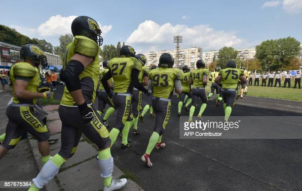 A picture taken on August 26 shows American Football players of Ukarnian team Kyiv Rebels entering the football field prior to an American Football...