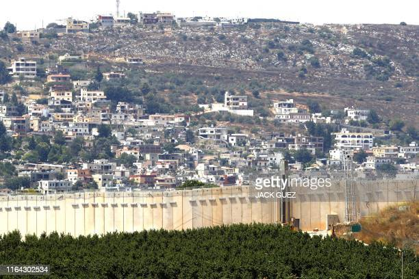 TOPSHOT A picture taken on August 27 2019 shows a partial view of the concrete barrier along the border with Lebanon and the southern Lebanese...