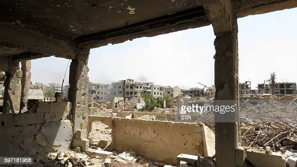 A picture taken on August 28 2016 shows damaged and collapsed buildings in the Syrian town of Daraya as government forces moved into the town just...