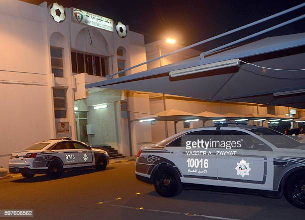 Picture taken on August 28, 2016 shows police cars outside the Kuwaiti football association headquarters in Kuwait City, as a strong police presence...