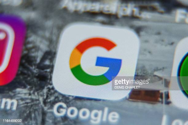 A picture taken on August 28 2019 shows the US multinational technology and Internetrelated services company Google logo application Amazon displayed...