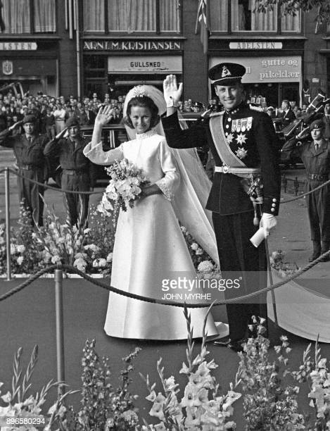 A picture taken on August 29 1968 shows Norway's Crown Prince Harald and Sonja Haraldsen wave as they leave the Oslo Cathedral during their wedding...