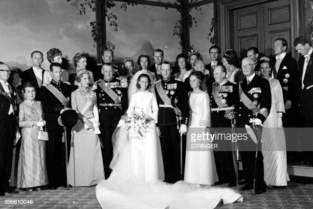 A picture taken on August 29 1968 shows Norway's Crown Prince Harald and Sonja Haraldsen posing with guests at the Royal Palace during their wedding...