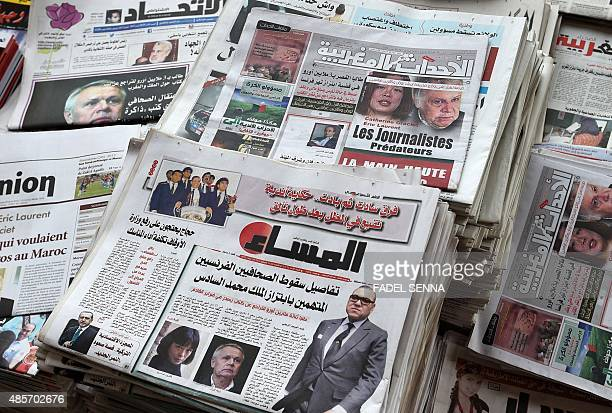 A picture taken on August 29 2015 in Rabat shows issues of daily newspapers in Arabic Al Ahdath Al Maghribia and AlMassae with on their covers...