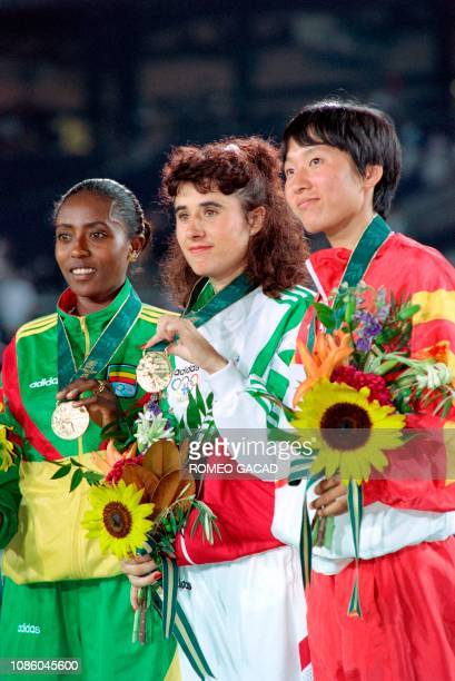 Picture taken on August 3, 1996 shows Fernanda Ribeiro from Portugal , Wang Junxia from China and Gete Wami from Ethiopia smiling from the podium of...