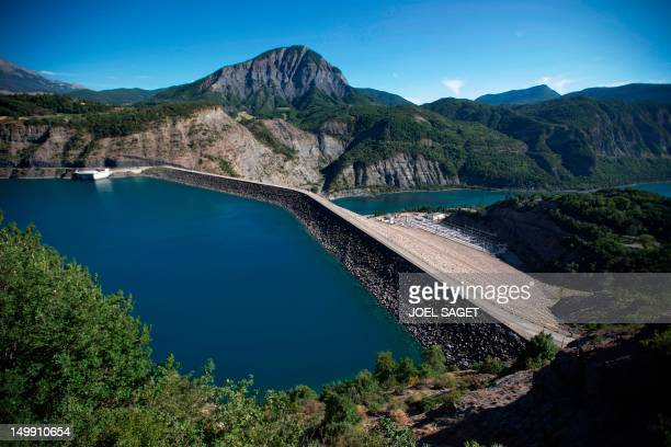 Picture taken on August 3, 2012 in Savines-le-Lac shows the Serre-Ponçon dam, the largest earth dam in Europe. The construction of the dam started in...