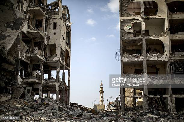 A picture taken on August 3 2014 shows destroyed buildings in front of a mosque in the northern Gaza Strip town of Beit Hanun as the IsraeliHamas...