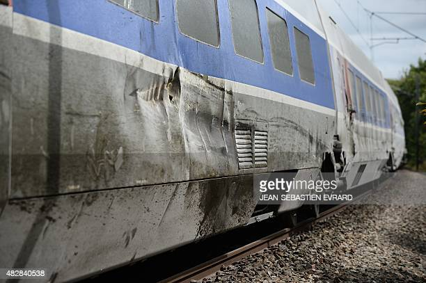 A picture taken on August 3 2015 in NoyalsurVilaine near Rennes western France shows a TGV High Speed train of the French national rail service SNCF...