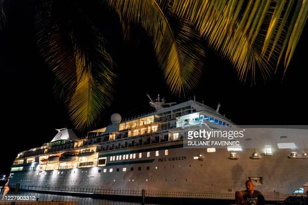 Picture taken on August 3, 2020 at night shows the cruise liner Paul Gauguin moored in Papetee's harbour, Tahiti, in French Polynesia after a case of...