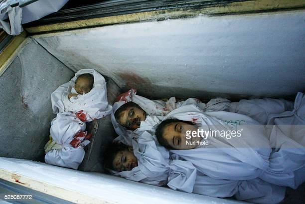 picture taken on August 3 at the morgue in Rafah in the southern Gaza Strip shows the bodies of a baby and two children lying in an icecream freezer...