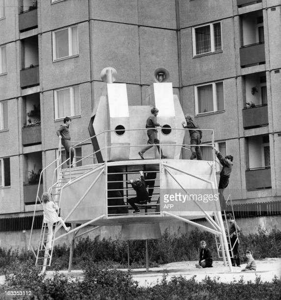 A picture taken on August 31 1973 in Szekesfehervar western Hungary shows children playing on the playground of the Kun Bela housing estate The...