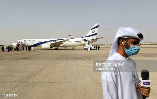 Picture taken on August 31 shows an Emirati reporter waiting for the opening of the door of the El Al's airliner, which is carrying a US-Israeli...