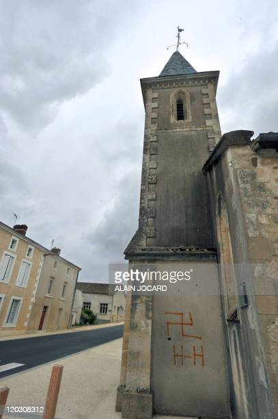 A picture taken on August 4 2011 in the French central town of Fomperron shows a swastika and nazi inscriptions on a church As the vandals sprayed...