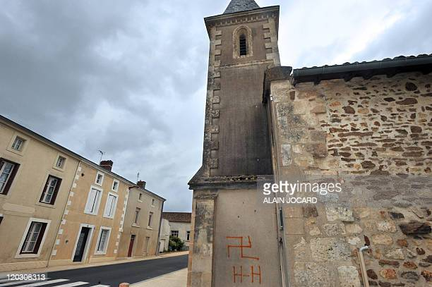 Picture taken on August 4, 2011 in the French central town of Fomperron shows a swastika and nazi inscriptions on a church. As the vandals sprayed...