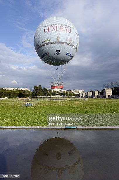 A picture taken on August 4 2014 at the Andre Citroen park in Paris shows the Airparif weather balloon the organisation in charge of monitoring the...