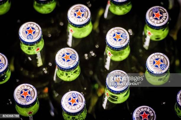 A picture taken on August 4 2017 shows Heineken beer bottles of the alcohol free beer brand Heineken 00 on the conveyor belt during the production in...