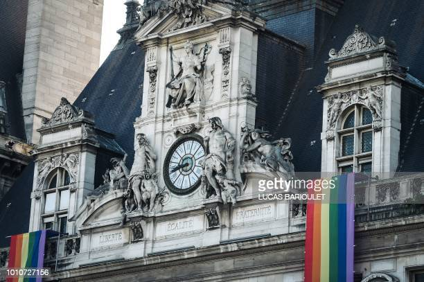 A picture taken on August 4 2018 shows the Paris City Hall decorated with rainbow flags during the inauguration of the sport village of the 2018 Gay...