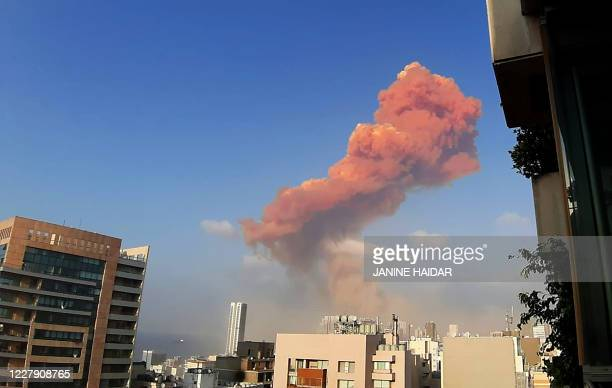 Picture taken on August 4, 2020 from the Hamra district in the centre of the Lebanese capital Beirut shows a smoke plume rising following a huge...