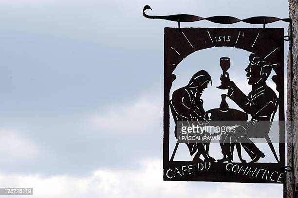 A picture taken on August 5 2013 shows a sign 'Cafe du commerce' in the village of Lauzerte southwestern France AFP PHOTO / PASCAL PAVANI