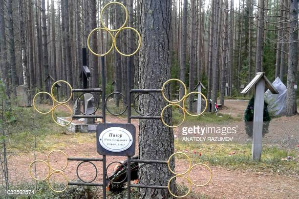 A picture taken on August 5 2018 shows a grave of a person killed in 1937 in the Sandarmokh a memorial site in a pine forest in the Karelia region at...