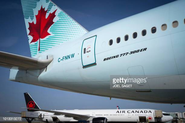 A picture taken on August 6 2018 shows Air Canada planes on the tarmac of RoissyCharles de Gaulle Airport north of Paris