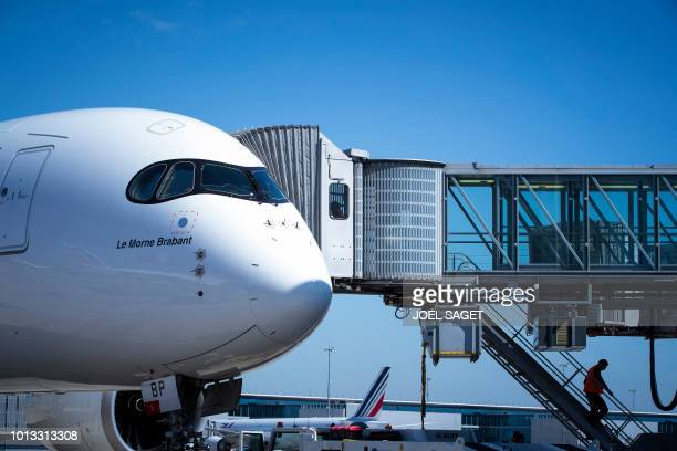 A picture taken on August 6 2018 shows an Air Mauritius plane on the tarmac of RoissyCharles de Gaulle Airport north of Paris
