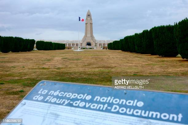 Picture taken on August 6, 2019 shows an information board at the World War I cemetery and the Ossuary of Douaumont, dedicated to the memory of...