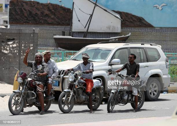 A picture taken on August 7 2018 during a trip in Yemen organised by the UAE's National Media Council shows Yemeni men riding motorcycles in the...