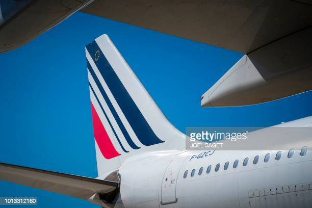 A picture taken on August 7 2018 shows an Air France plane parked on the tarmac of RoissyCharles de Gaulle Airport north of Paris