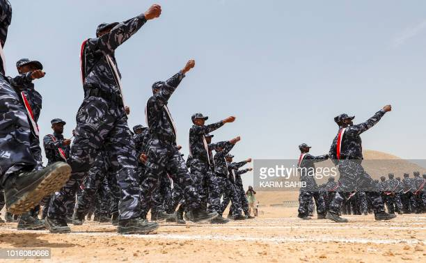 A picture taken on August 8 2018 during a trip in Yemen organised by the UAE's National Media Council shows UAEtrained cadets of the Yemeni police...