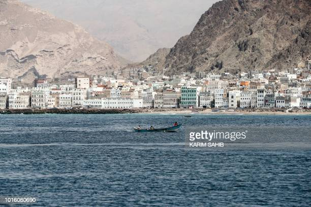 A picture taken on August 8 2018 during a trip in Yemen organised by the UAE's National Media Council shows a skiff sailing off the waterfront of the...