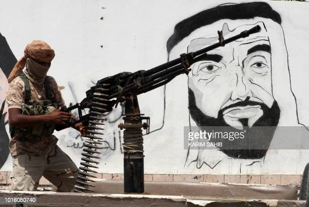 A picture taken on August 8 2018 during a trip in Yemen organised by the UAE's National Media Council shows a soldier loyal to the Saudi and...
