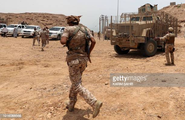 Picture taken on August 8, 2018 during a trip in Yemen organised by the UAE's National Media Council shows a Yemeni soldier loyal to the Saudi and...