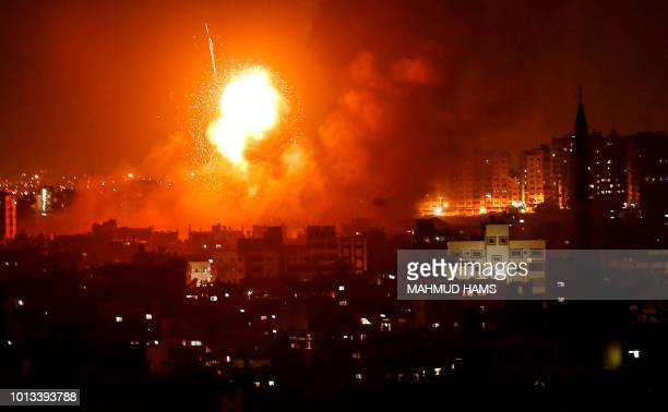 A picture taken on August 8 2018 shows a fireball exploding during Israeli air strikes in Gaza City