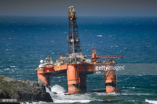 A picture taken on August 8 shows the Transocean Winner oil rig after it ran aground at Dalmore on the Isle of Lewis in northern Britain during a...