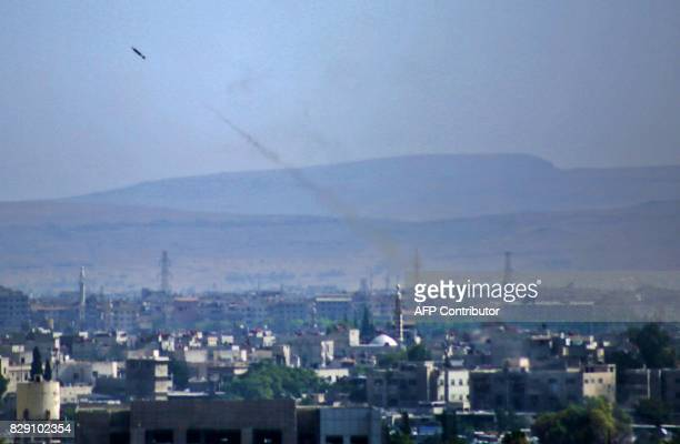 A picture taken on August 9 2017 shows a surfacetosurface missile reportedly being fired by Syrian government forces from Damascus towards rebelheld...