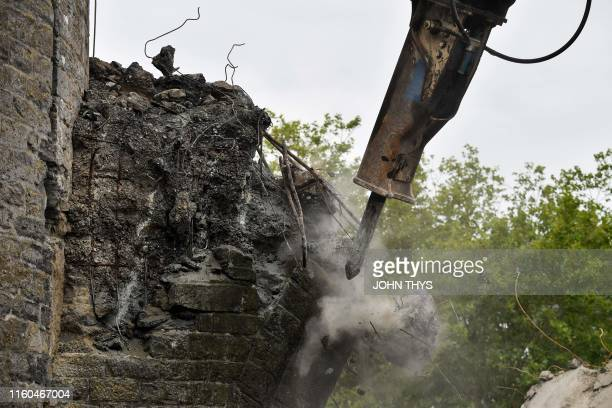 "Picture taken on August 9, 2019 shows a close-up of the ""Pont des Trous"" medieval bridge as it is being demolished in Tournai, where the Scheldt..."
