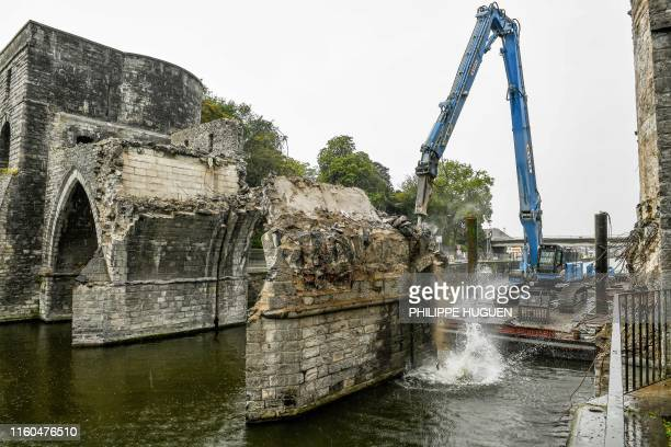 "Picture taken on August 9, 2019 shows a general view of the ""Pont des Trous"" medieval bridge being demolished in Tournai, where the Scheldt river..."