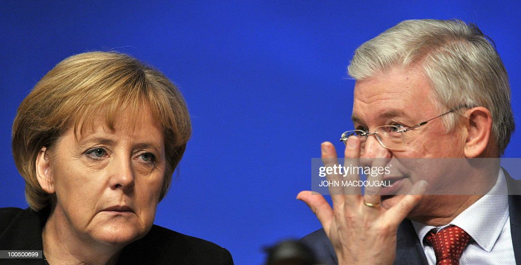 FILES - Picture taken on December 1, 2008 shows German Chancellor Angela Merkel with Hesse State Premier Roland Koch during the annual congress of the Christian Democratic Union (CDU) in Stuttgart, southern Germany. Koch, a powerful rival of German Chancellor Angela Merkel and a big-hitting regional baron in her party announced his surprise resignation on May 25, 2010, but denied it was due to any spat.