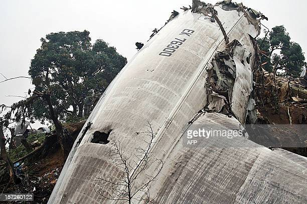 A picture taken on December 1 2012 shows debris of the cargo plane that crashed at Brazzaville airport as it was trying to land in a storm on the eve...
